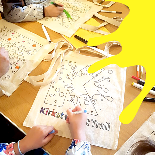 Colouring in tote bags at last year's Kirkstall Art Trail